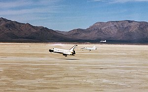 STS-3 - STS-3 landing at Northrop Strip, White Sands, New Mexico, on 30 March 1982, with two T-38 Talon chase planes observing.