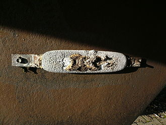 Cathodic protection - Galvanic sacrificial anode attached to the hull of a ship, showing corrosion.
