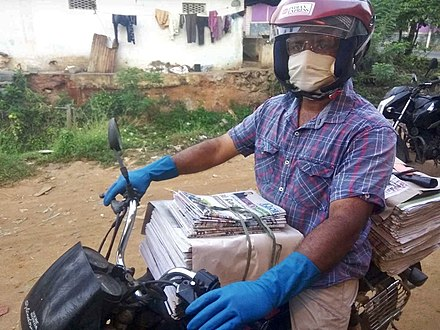 A Newspaper Vendor in Tamilnadu, India wearing goggles, mask and hand-gloves which is hither to an unusual scene in India Safe Newspaper Vendor - coronavirus.jpg