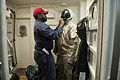 Sailors prep for drill aboard USS Donald Cook 150228-N-JN664-086.jpg