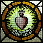 Saint Vincent de Paul Catholic Church (Mount Vernon, Ohio) - stained glass, Charity.JPG