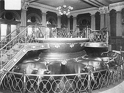 Baptismal font in the Salt Lake Temple, circa 1912, where baptisms for the dead are performed by proxy. The font rests on the backs of twelve oxen representing the Twelve Tribes of Israel