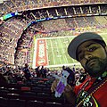 San Francisco fan practicing anti-Ravens Voodoo at Super Bowl 2013.jpg