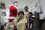 Santa Claus visits Craig Joint Theater Hospital DVIDS234271.jpg