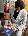 Satinder Sartaaj the famous Sufi songs signing a copy of the British Sikh Report.jpg
