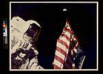 Schmitt with Flag and Earth Above (3747528256).jpg