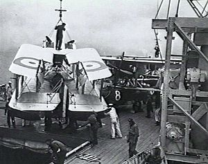 HMAS Albatross (1928) - A Seagull III amphibian being manoeuvred towards the hangar hatch following recovery