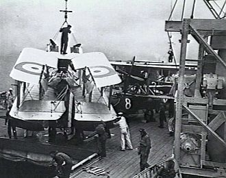 HMAS Albatross (1928) - A Seagull III amphibian being manoeuvred towards the hangar hatch following recovery