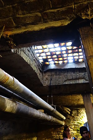 Seattle Underground - A view looking upwards at the pavement lights (glass skywalks). These roof the previous street level; the top of the glass is walked upon, and forms the current sidewalk