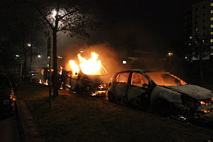 Second day of Husby riots, three burning cars.jpg