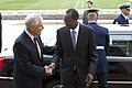 Secretary of Defense Chuck Hagel, left, greets Burkina Faso President Blaise Compaore upon his arrival at the Pentagon in Arlington, Va 130923-D-BW835-090.jpg