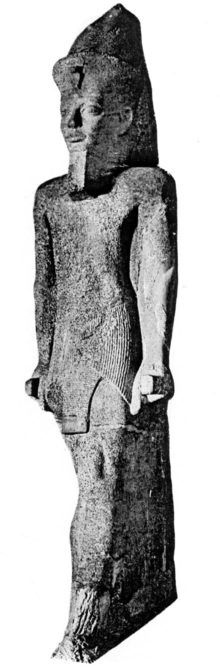 Colossal statue CG 42026 of Senusret IV, discovered in 1901 by Georges Legrain in Karnak.[1]