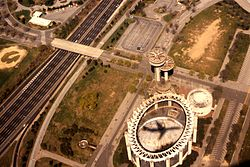 Shadow of airplane crosses the New York State Pavilion at Flushing Meadows in 1981.jpg