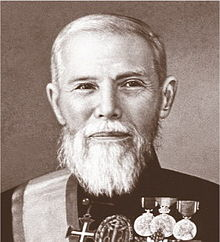 Sepia portrait of a distinguished man with a white beard wearing his decorations