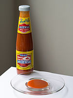 Sriraja Panich chili sauce by Thai Theparos Food Products (left) and ...