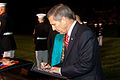 Sloan Gibson, the president of the USO and Evening Parade guest of honor, signs a guest book following the Evening Parade May 24, 2013, at Marine Barracks Washington in Washington, D.C. Evening Parades 130524-M-MM982-304.jpg