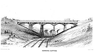 John Cooke Bourne - Sonning Cutting, close to the scene of an accident in 1842 caused by a slip in the bank. Workmen are repairing bank-slips on the southern side of the cutting at left. Print by JC Bourne published in 1846.