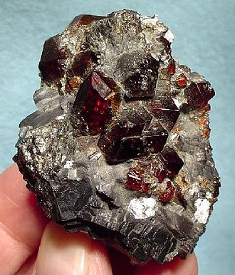 Broken Hill ore deposit - Spessartine garnet crystals in massive galena, Broken Hill