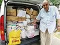 Srba Ignjatović donating books to Adligat.jpg