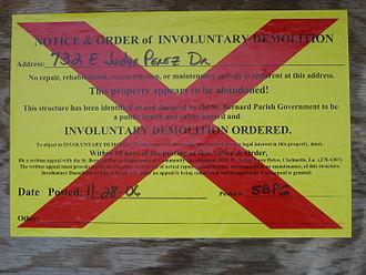 "St. Bernard Parish, Louisiana - ""Involuntary Demolition"" notice, posted on buildings in St. Bernard Parish when there has been no significant effort to gut, secure, or repair the building over a year after Hurricane Katrina."