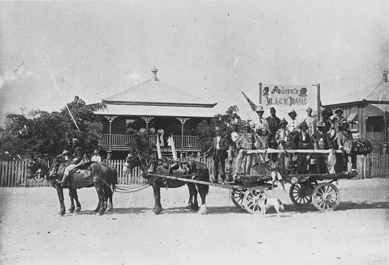 File:StateLibQld 1 192843 Travelling entertainers on an open wagon in Charters Towers.jpg