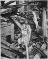 Still standing in the rubble of a church in the war-blasted town of Dulag, a statue of the sacred heart appears to... - NARA - 513209.tif