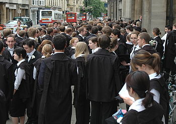 Students in academic dress outside the Exam Sc...