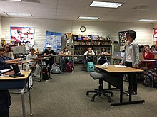 Students act out a mock trial in their classroom