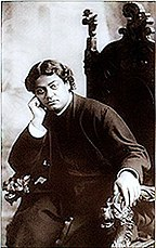 Image of Vivekananda relaxing in a chair.