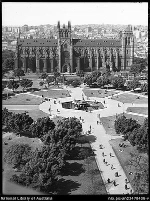 St Mary's Cathedral, Sydney - St Mary's Cathedral from the west with Hyde Park in the foreground. 1940s