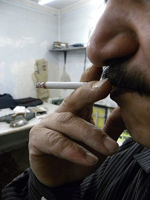 Smoking in Iran - An Iranian man smoking interior