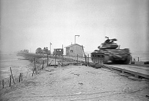 Battle of Uijeongbu (1951) - Tanks crossing Han River before being blown.