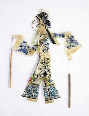 Shadow play - This Chinese shadow puppet is illustrative of the ornate detail that goes into the figures. In the collection of The Children's Museum of Indianapolis.