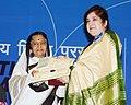 The President, Smt. Pratibha Devisingh Patil presenting the Rajat Kamal Award to Ms. Romita Bose for the Best Bengali Film (Bengali Ami Adu), at the 58th National Film Awards function, in New Delhi on September 09, 2011.jpg