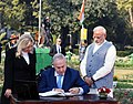 The Prime Minister of Israel, Mr. Benjamin Netanyahu signing the visitors' book, at Teen Murti Chowk, in New Delhi on January 14, 2018. The Prime Minister, Shri Narendra Modi is also seen.jpg
