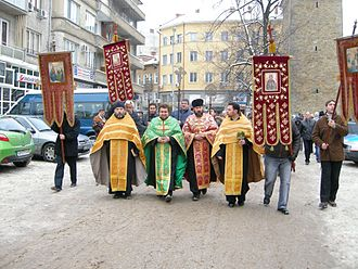 """Gabrovo - Bulgarian Orthodox Theophany Crucession in Gabrovo. The priests are going to throw a wooden cross in the Yantra. Believers will then jump into the icy waters to """"save"""" the cross."""