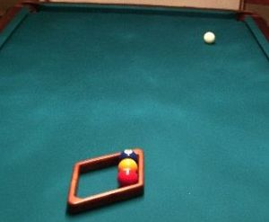 A three-ball straight rack, using the side of the nine-ball diamond rack to align the balls with the head and foot spots. [wider view] Three-ball straight rack in diamond 1a.jpg