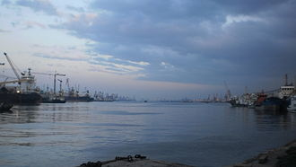 Layout of the Port of Tianjin - The Tianjin Xingang Main Basin at dusk, seen from the western end of the harbor at the Xingang Shiplock