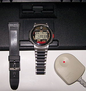 """Timex Datalink - Timex Datalink 50 model 70518 and resin strap of model 70301 with binary ASCII code translating as: """"Listen To The Light If You Can See"""""""