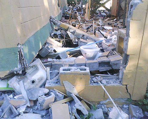 A toilet in a collapsed apartment building in Paniahue, Santa Cruz. Image: Diego Grez.