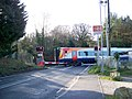 Train on the level crossing, Moreton - geograph.org.uk - 1636895.jpg