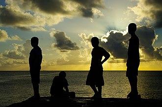 Demographics of Tuvalu - Children on a wharf at Funafuti lagoon