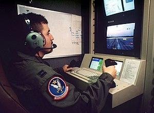 U.S. Air Force officer controls a Predator aircraft in flight 1998.jpg