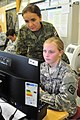 U.S. Army Pfc. Karlea E. Henderson, right, a human resources specialist assigned to the 18th Engineer Brigade, 21st Theater Sustainment Command, and Croatian army Maj. Ruzica Pavic Kevric, a medical practitioner 130826-A-UV471-001.jpg