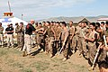 U.S. Marine Corps 1st Lt. Ryan Trunk, left foreground, with Law Enforcement Battalion, III Marine Expeditionary Force (MEF) Headquarters Group, III MEF, shakes hands with a Mongolian soldier after a mechanical 130819-M-DR618-052.jpg