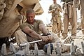 U.S. Marine Corps Sgt. Christopher Cannella, a tank mechanic assigned to Delta Company, 1st Tank Battalion, prepares a tank track while conducting maintenance on an M88A2 Hercules recovery vehicle at Forward 130507-M-YH552-091.jpg
