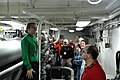 U.S. Navy Aviation Boatswain's Mate (Equipment) 3rd Class Carissa Clark, left, leads a group of civilian visitors on a tour of an arresting gear engine room aboard the aircraft carrier USS Ronald Reagan 131107-N-AV746-638.jpg