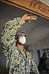 U.S. Navy Builder 3rd Class Ismael Rodriguez, assigned to the high speed vessel Swift (HSV-2), helps paint an orphanage during Africa Partnership Station (APS) 2012 in Pointe Noire in the Republic of the Congo 120905-F-BU402-470.jpg