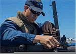 U.S. Navy Fire Controlman 2nd Class Samuel Murfree loads a .50-caliber machine gun during a live-fire exercise aboard the guided missile cruiser USS San Jacinto (CG 56) in the Atlantic Ocean July 24, 2013 130724-N-LN619-027.jpg