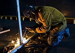U.S. Navy Fireman Christopher Baddour welds support on a chin-up bar on the amphibious dock landing ship USS Tortuga (LSD 46) during Cooperation Afloat Readiness and Training (CARAT) 2013 in the Gulf of Thailand 130608-N-IY633-118.jpg